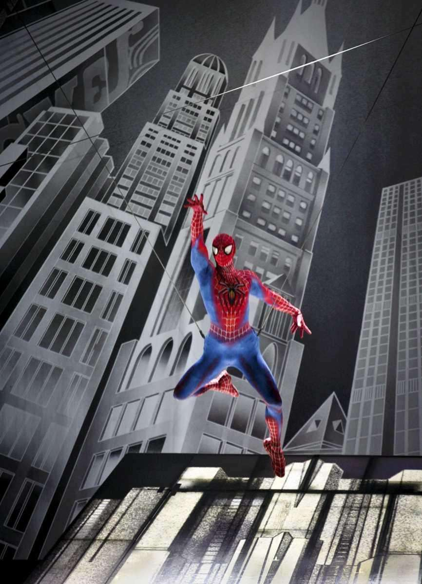 Reeve Carney as Spider-Man flies off the stage