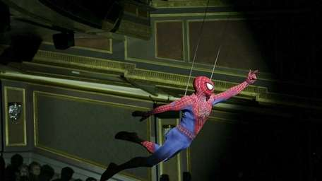Spider-Man flies across the theater during a preview