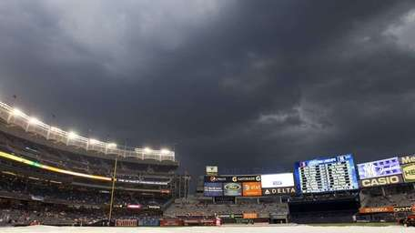 Storm clouds form over Yankee Stadium before the