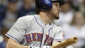 New York Mets' Daniel Murphy watches his run-scoring