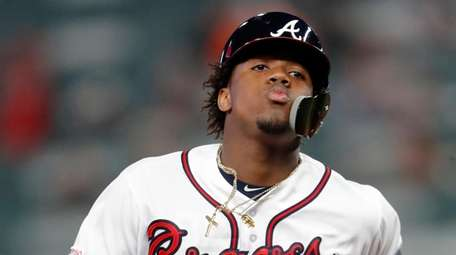 The Braves' Ronald Acuna Jr. rounds the bases