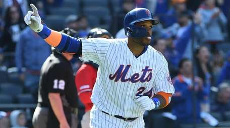 Mets second baseman Robinson Cano reacts on his