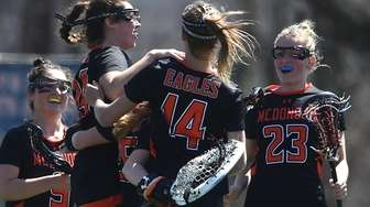 McDonogh (MD) girls lacrosse teammates celebrate after their