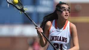 Olivia Dooley of Manhasset moves the ball downfield