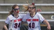 Stony Brook's Sara Moeller is congratulated by teammate