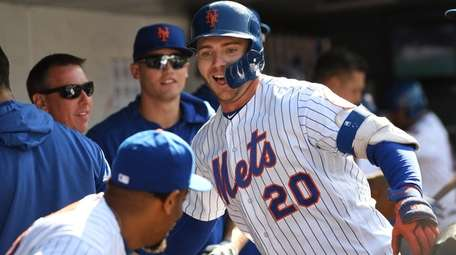 Pete Alonso is all smiles in the dugout