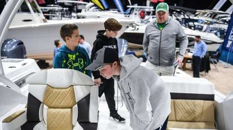 Rowan Grawehr checks out a boat with his