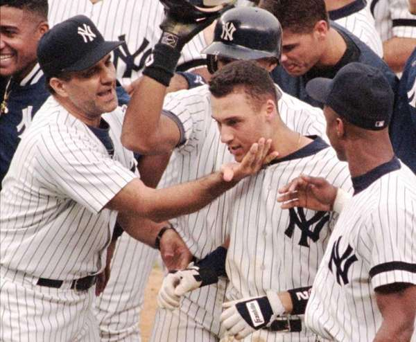 Yankees manager Joe Torre, left, pats Derek Jeter,