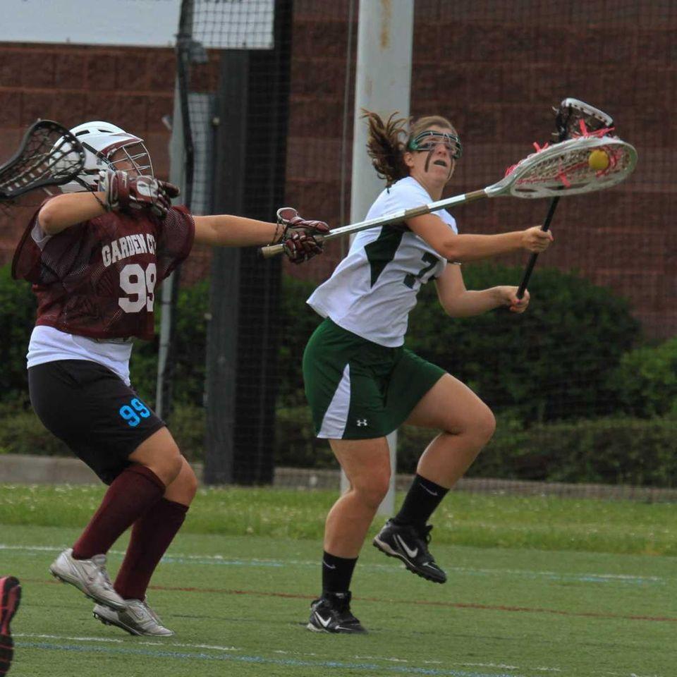 Garden City's Goalie Kelly Weis defends her goal