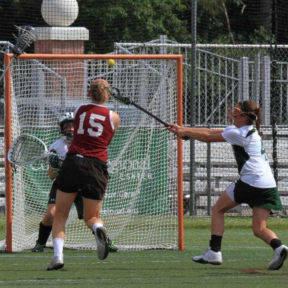 Garden City's Mikaela Rix shoots and scores during