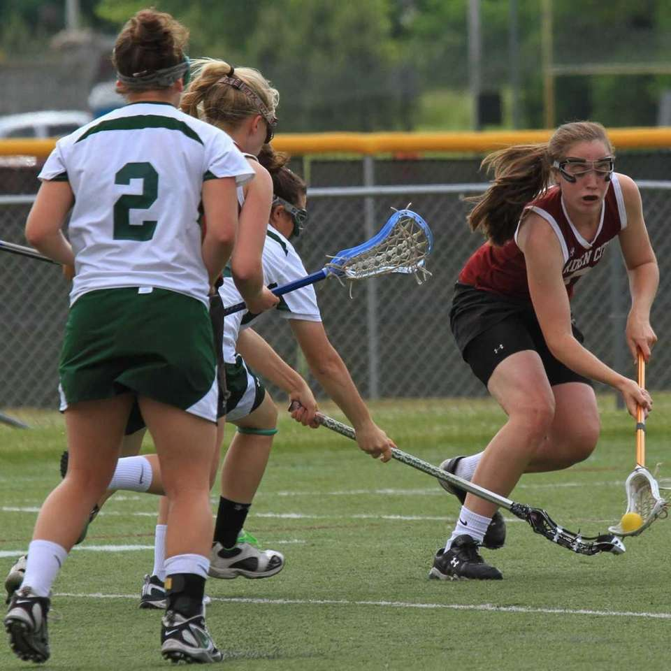 Garden City's Kate Butcher scoops up a loose