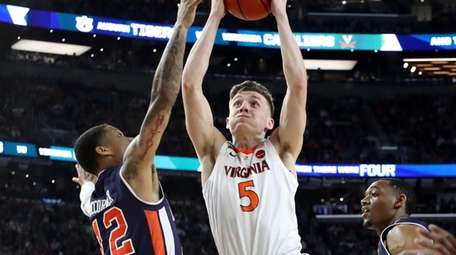 Kyle Guy, shown here driving to the basket