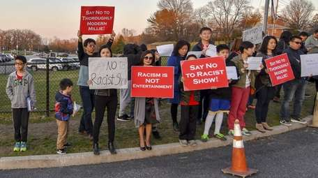 Protesters gather outside Huntington High School on Saturday