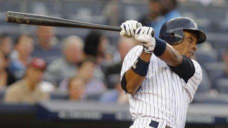 New York Yankees' Curtis Granderson hits a home