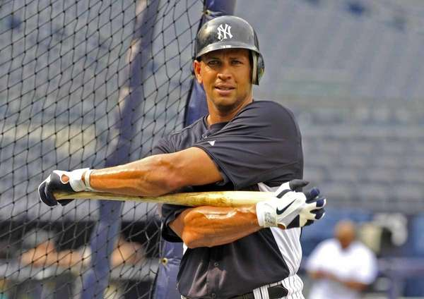Alex Rodriguez stretches out his upper body around