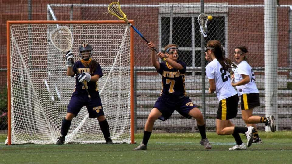 Northport's #7 Allie Pavinelli helps guard the goal