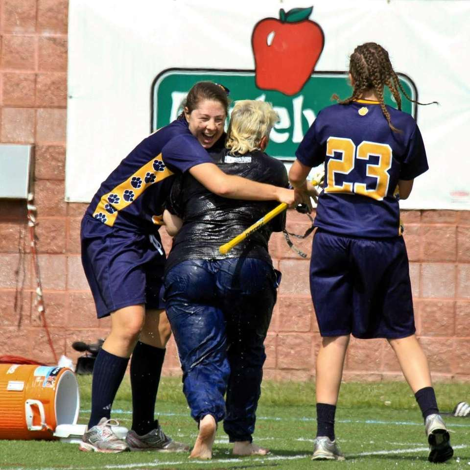 Northport's #8 Jessica Nelson helps her coach up