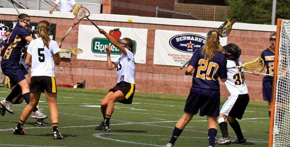 Northport's #8 Jessica Nelson fires and scores a