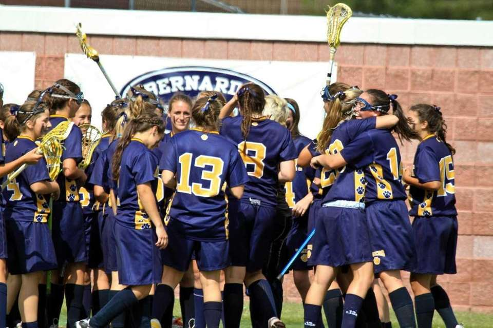 Northport's girls lacrosse team celebrate their win at