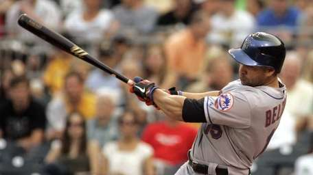 Carlos Beltran of the Mets gets a hit