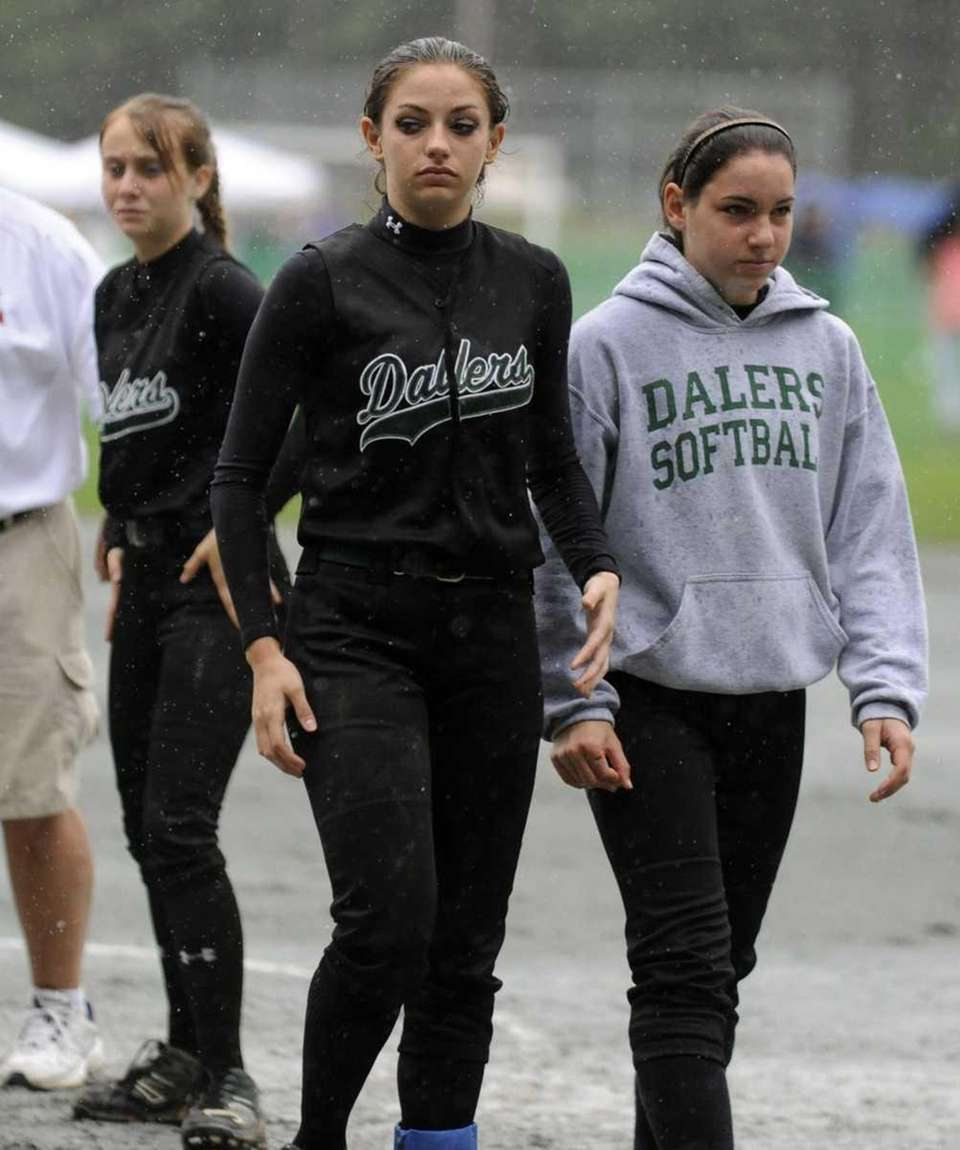 Farmingdale players walk off the field after losing