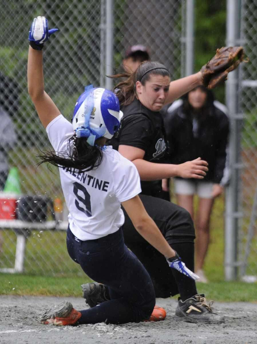 Farmingdale's Isabella Corrao tries to tag out John