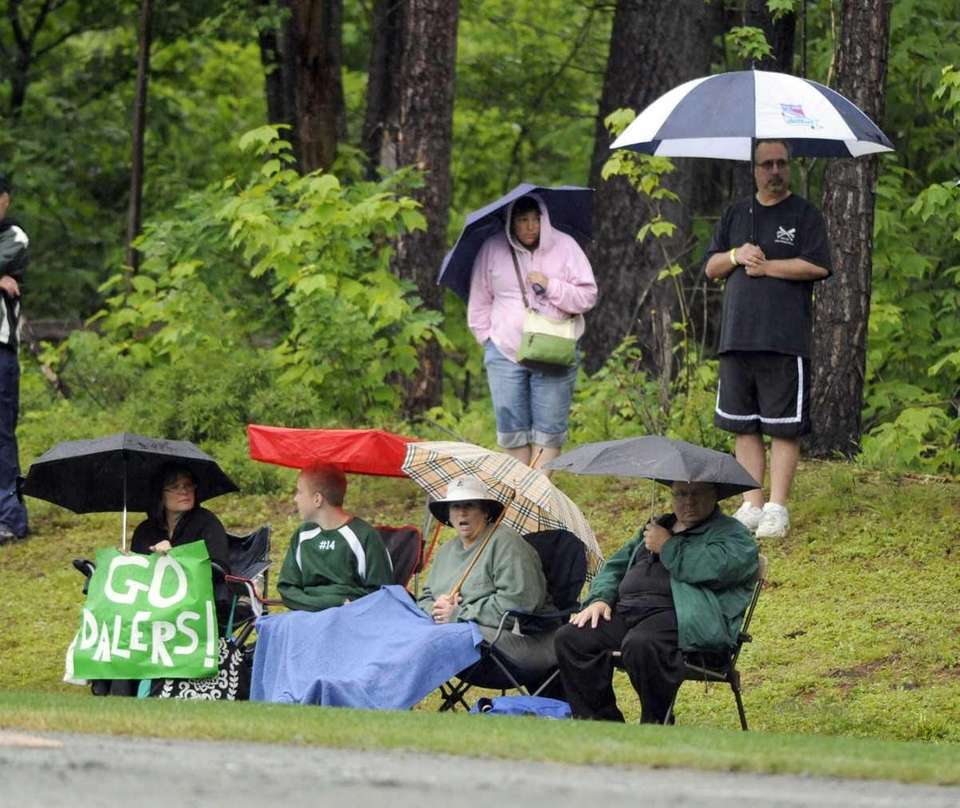 Farmingdale fans try to stay dry during a