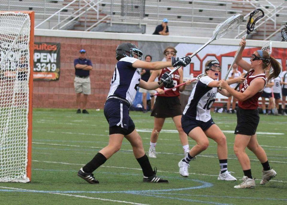 Garden City's Catherine Dickinson scores a goal against