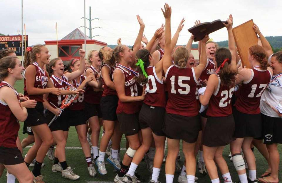 Garden City players celebrate with the championship trophies