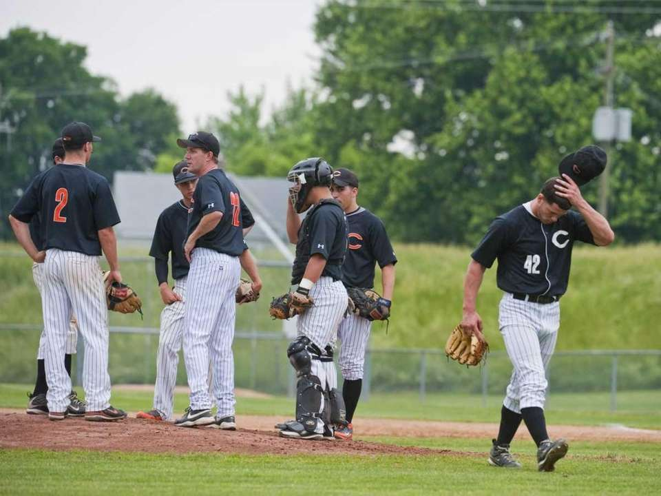 Carey pitcher John Daddino, right, leaves the game