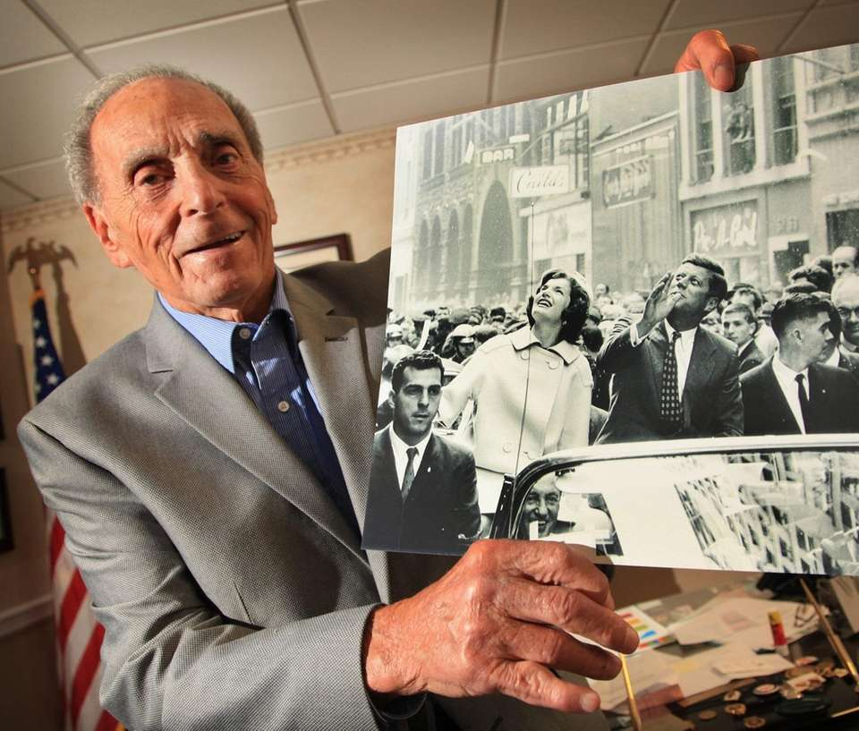 Vecchio holds a photo of himself, lower left,