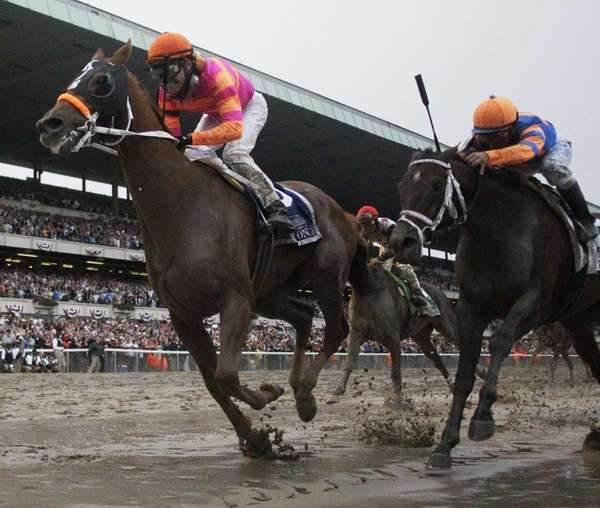 Ruler On Ice, left, with jockey Jose Valdivia