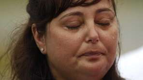 Lynn Barthelemy, mother of slain victim Melissa, crying