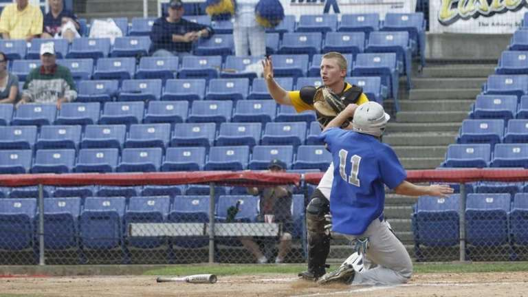 Division's Johnny Muller scores their only run in