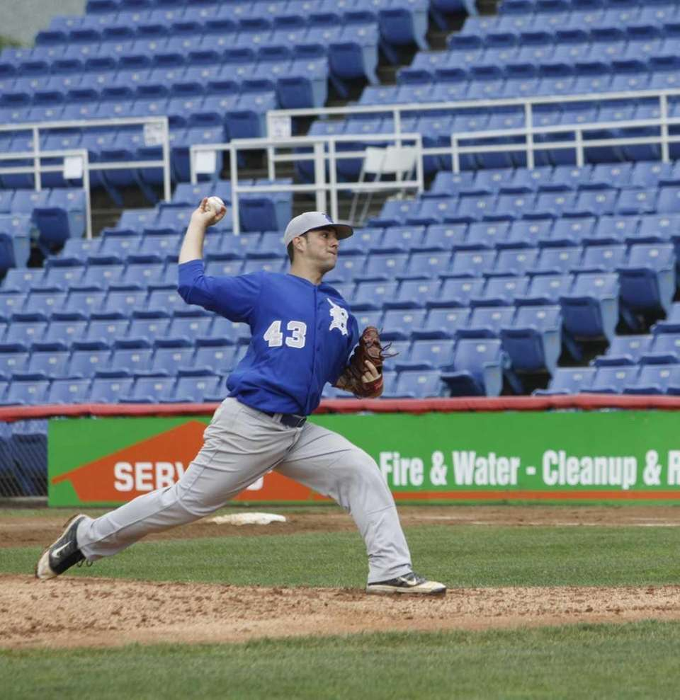Pitcher Sean Abbate throws a strikeout in the