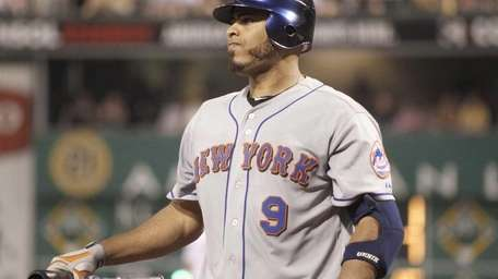 The Mets' Ronny Paulino steps out of the