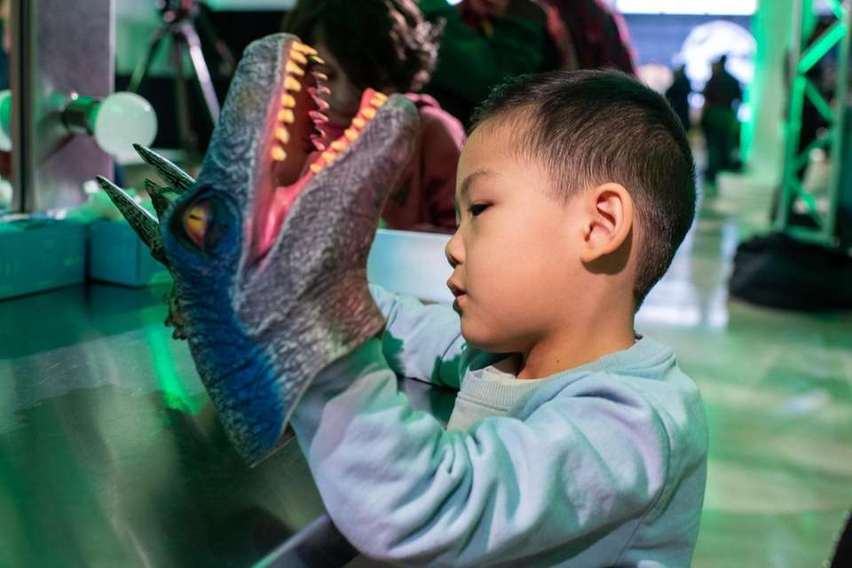 Chase Wu, 5, of Manhattan plays with hand