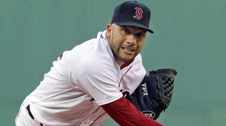 Boston Red Sox starting pitcher Alfredo Aceves delivers