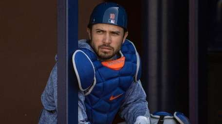 Mets catcher Travis d'Arnaud looks on during a