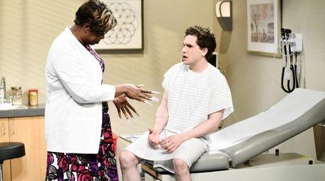 Leslie Jones as Dr. DeMarsha and host Kit