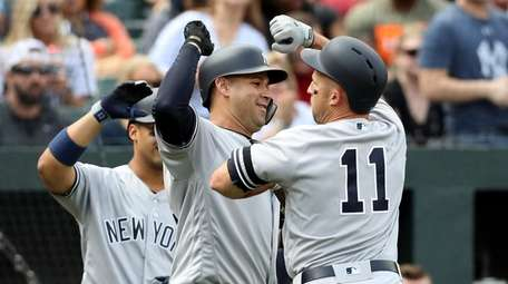 The Yankees' Gary Sanchez, No. 24,celebrates with Brett