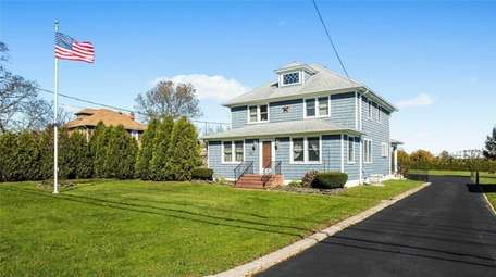 This Cutchogue farmhouse, for $699,000, includes four bedrooms