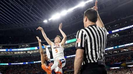 Kyle Guy #5 of the Virginia Cavaliers attempts