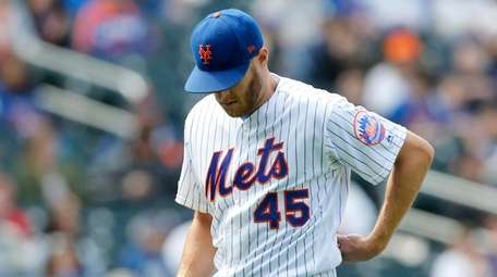 Zack Wheeler, No. 45, of the Mets leaves