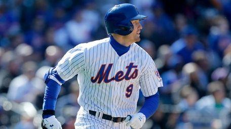 Brandon Nimmo #9 of the Mets runs to