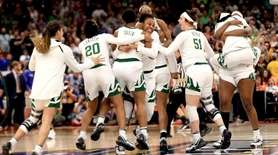 The Baylor Lady Bears celebrate their 82-81 win