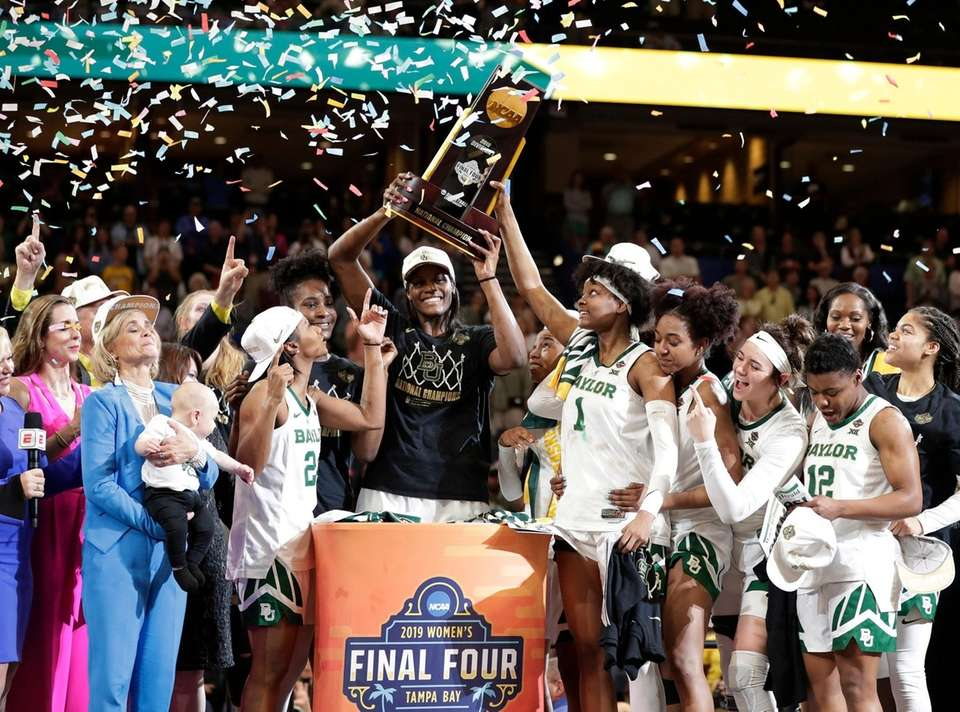 The Baylor team raises the championship trophy after
