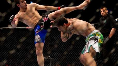 Kenny Florian, left, and Diego Nunes, fight in