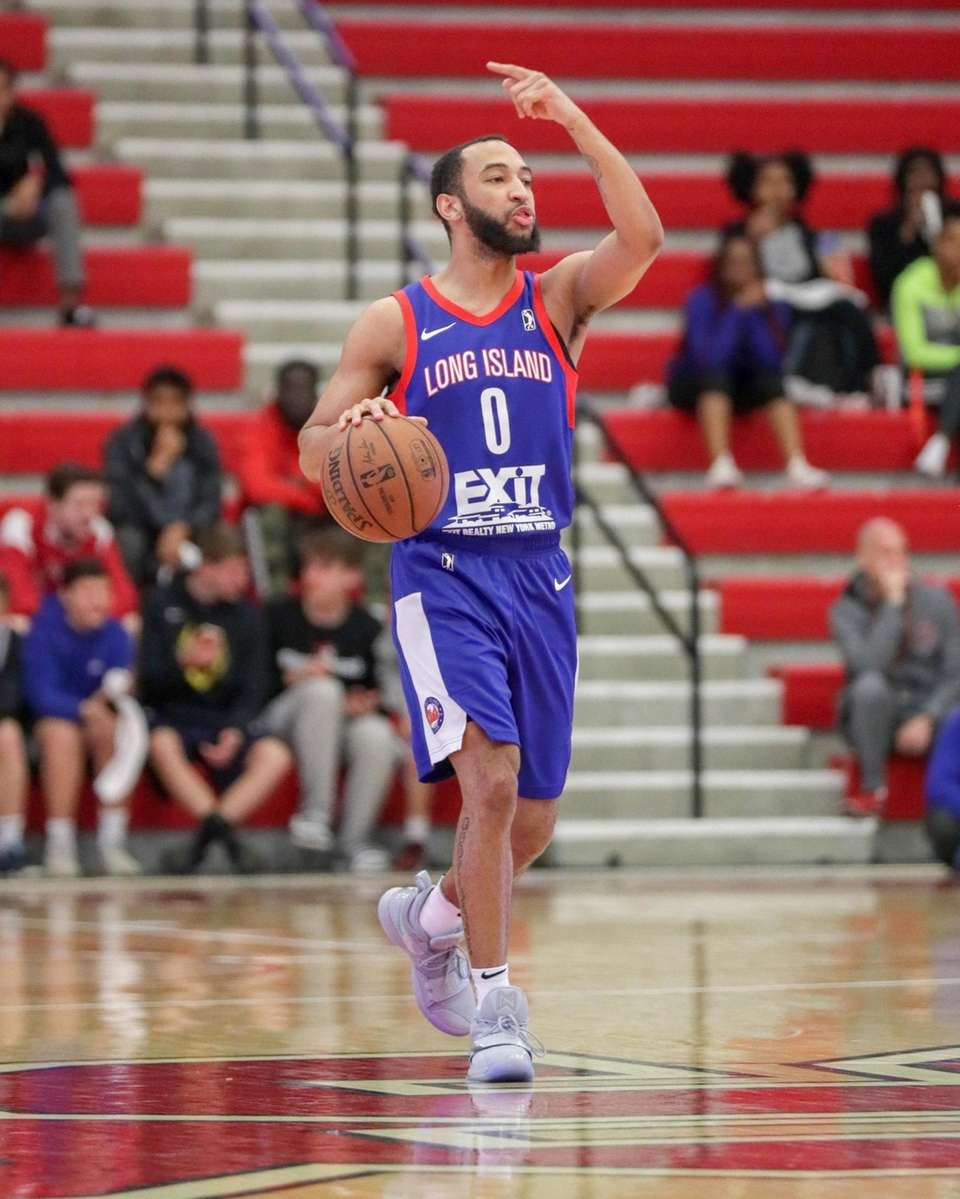 Long Island Nets guard Jordan McLaughlin #0 directs