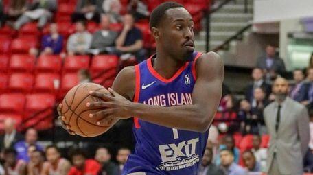 Long Island Nets forward Theo Pinson drives on